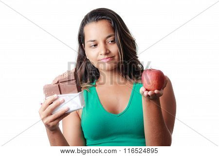Diet, Nutrition, Weight Loss And Choice Concept. Young Woman Chooses Between Chocolate And Apple On