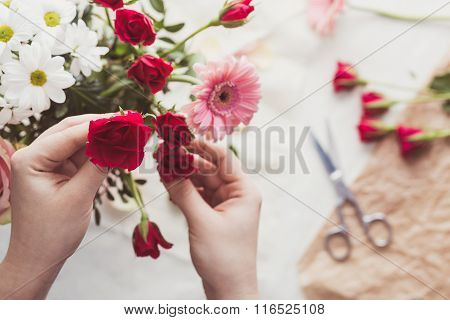 Putting Flowers In Bouquet