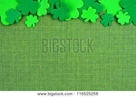 St Patricks Day top border of shamrocks over green linen