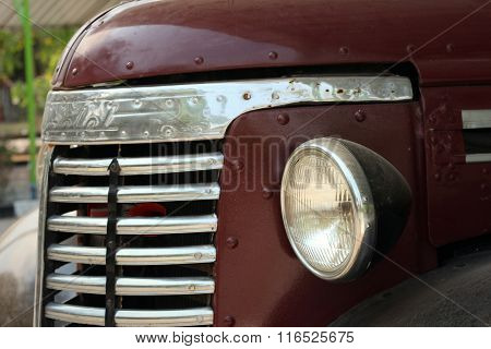 The Headlights Of A Car On The Street
