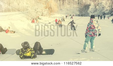 people watching snowboarders on background