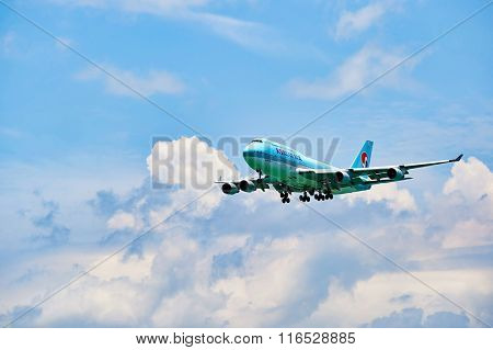 HONG KONG - JUNE 04, 2015: Korean Air aircraft landing at Hong Kong airport. Korean Air is the largest airline in South Korea based on fleet size, international destinations and international flights.