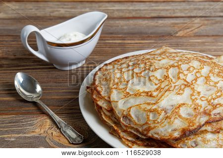 Closeup Pancakes On The Dish And Sour Cream