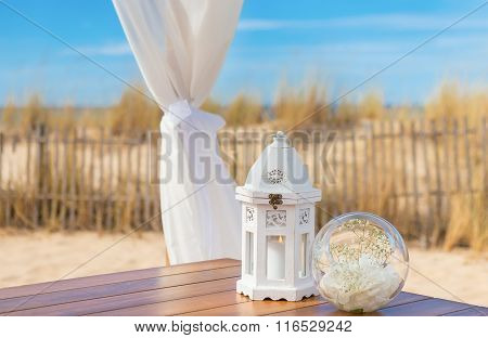 Wedding romantic decoration. Candle in a luminaire.