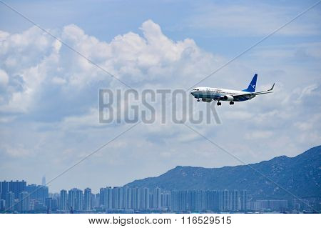 HONG KONG - JUNE 04, 2015: XiamenAir aircraft landing at Hong Kong airport. XiamenAir (formerly Xiamen Airlines) is the first privately owned airline in the People's Republic of China