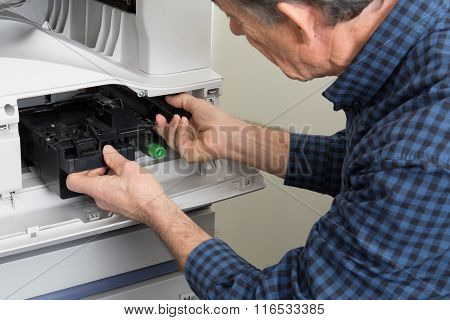 Closeup Shot  Male Technician Repairing Digital Photocopier Machine