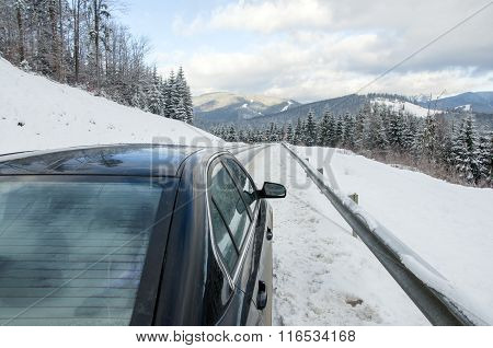Car On Winter Mountainins Road