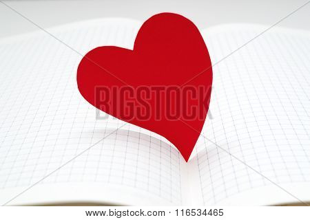 Close-up Of Open Diary With Paper Heart