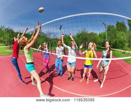 Fisheye view of teenagers playing volleyball