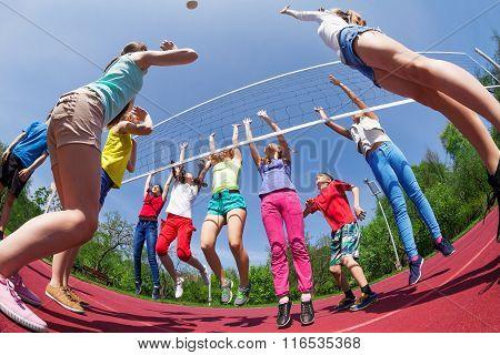 Fisheye view of children who play volleyball