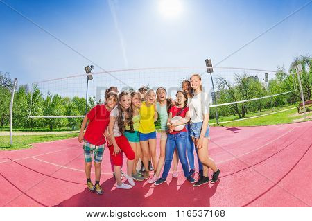 Cute teen boys and girls in volleyball team