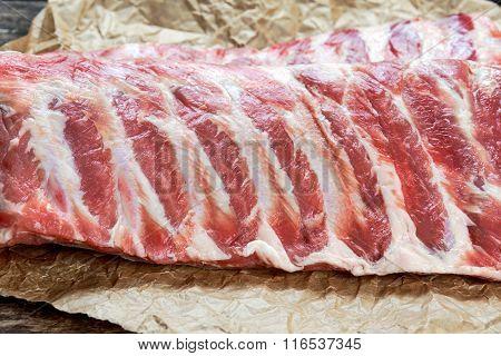 Raw Pork ribs, on crumpled paper