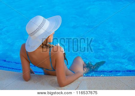 summer vacation or holiday woman relaxing in pool in Mallorca
