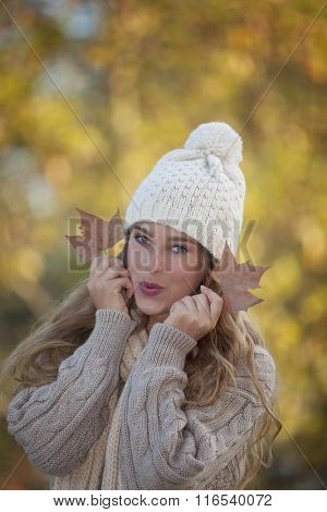 pretty fall or autumn teen girl holding leaves