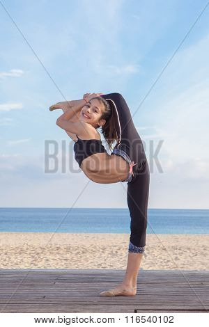 acrobatic flexible young girl dancer stretching