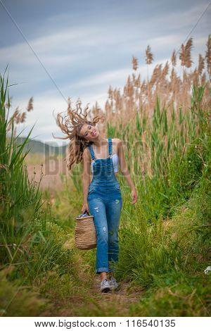 happy healthy girl walking in countryside