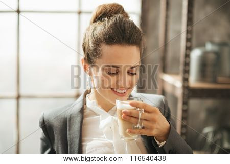 Smiling Businesswoman Enjoying Cup Of Coffee Latte Macchiato
