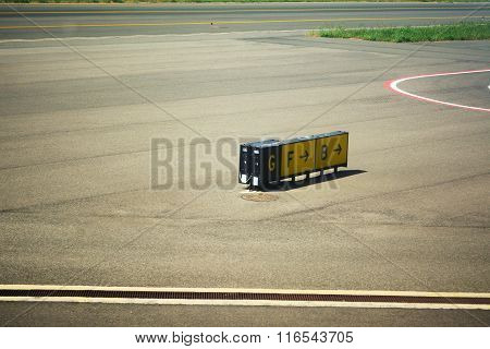 Direction Signs On An Airport Taxiway