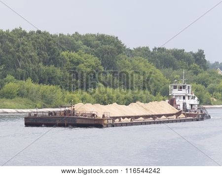 Barge Loaded With Sand Floats