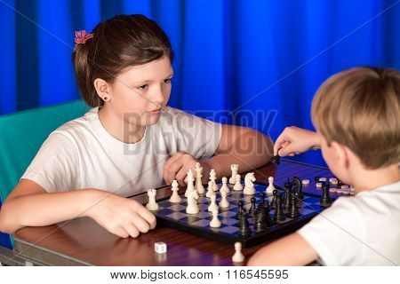 Children Play A Board Game Called Chess.