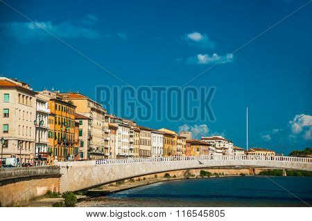 View of old street and river Arno in Pisa city, Italy