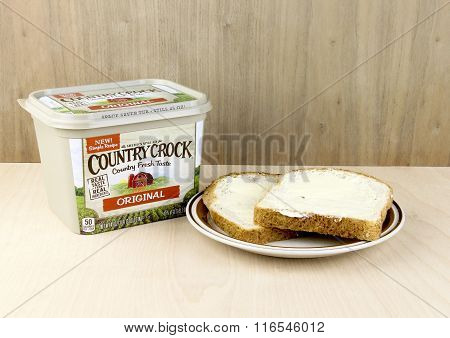 Container Of Country Crock Vegetable Oil Spread And Buttered Bread