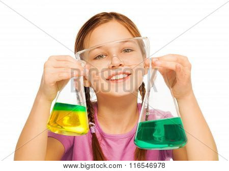 Young schoolgirl with results of chemical tests