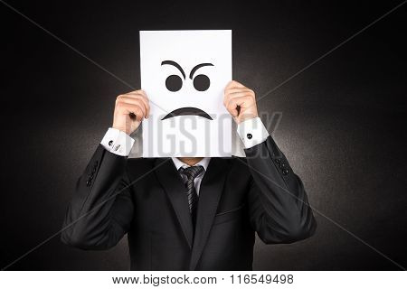 Businessman holding Angry emoji