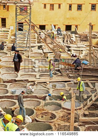 Laborers Working On Rehab In The Chouwara Leather Tannery In The Fez El Bali Medina.