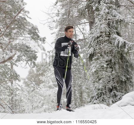 Distrustful Cross Country Skiing Man In The Beautiful Forest