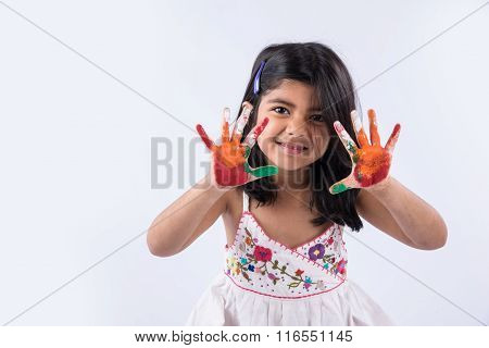 cute girl showing her colorful hands, surprised. Indian young girl with palm painted, asian girl and