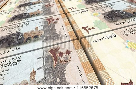 Syrian pounds bills stacks background. Computer generated 3D photo rendering.
