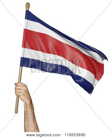 Hand proudly waving the national flag of Costa Rica