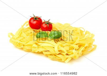 Raw Pasta With Fresh Tomatoes And Sprig Of Basil.