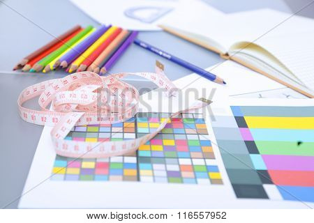 Designer table with blank note and tools