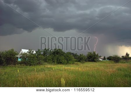 Thunderstorm With Lightning In The Village In Summer
