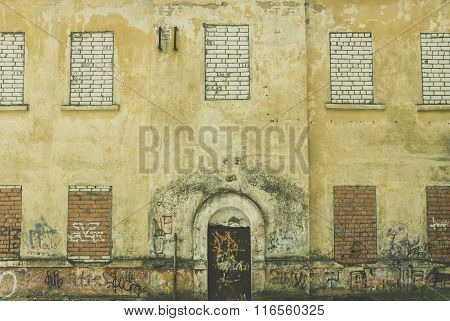 Facade Of An Old Building With A Door