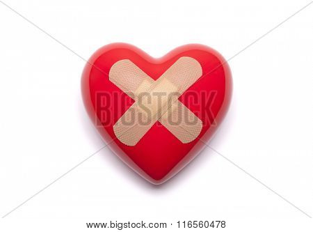 Red heart with bandages on white background