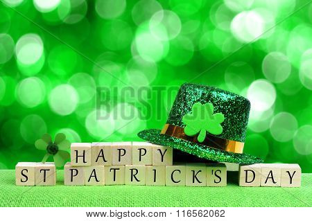 Happy St Patricks Day blocks, leprechaun hat over twinkling green