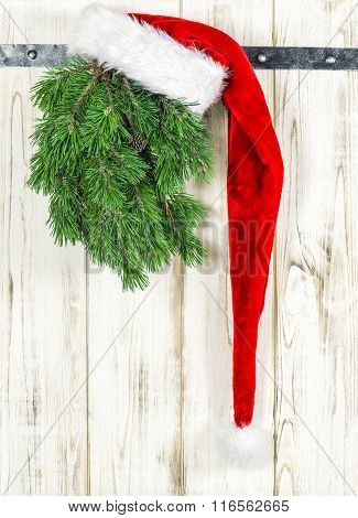 Red Hat And Green Christmas Tree Branch. Vintage Decoration