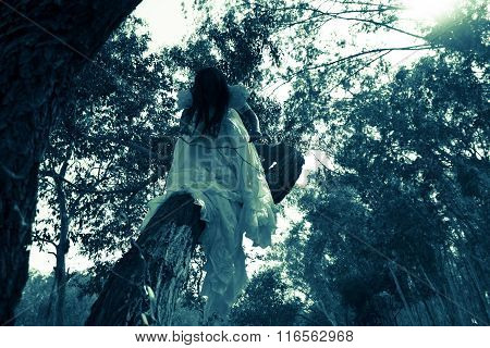 Mysterious Woman in White Dress in the Forest