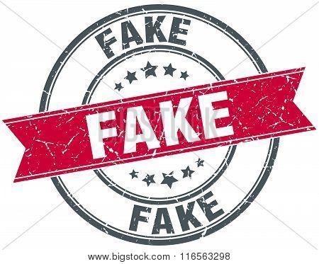 fake red round grunge vintage ribbon stamp