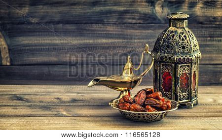 Ramadan Lamp And Dates On Wooden Background. Oriental Lantern