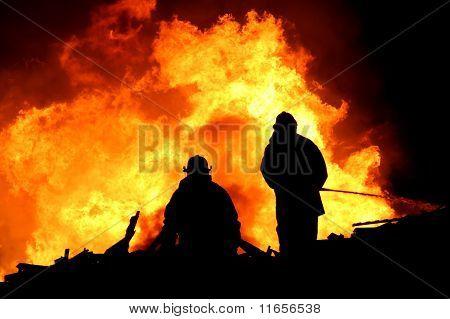 Firemen In Silhouette