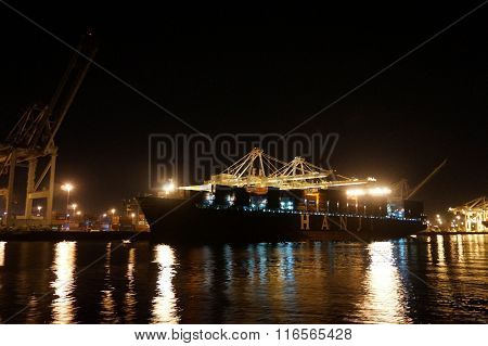 Fully Loaded Shipping Cargo Boat Unloaded At Night