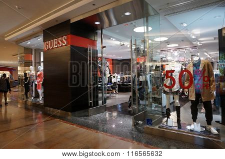 Guess Shop In Mall With 50 Percent Off Sign