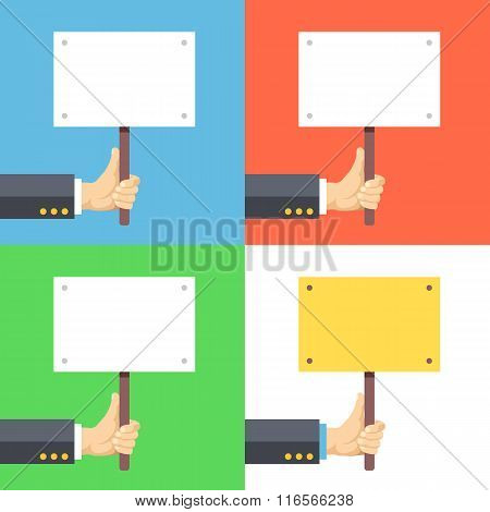 Hands holding empty placards, billboards with space for text