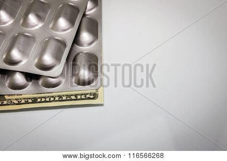 Silver Packages Of Pills Up Ticket Of 20 Dollars, Concept Of Health Copay