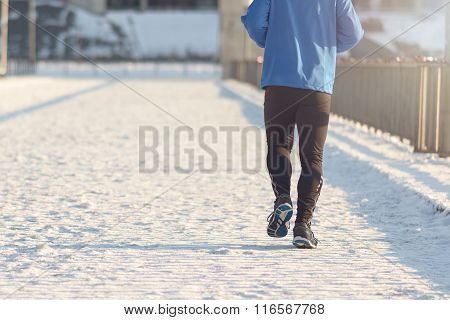 Man Jogging In Winter