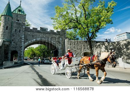 Quebec City Quebec Canada - Sept. 10 2015: Horse-drawn carriages take tourists to visit the sights in charming Old Quebec City. The walled city is a UNESCO World Heritage Site.